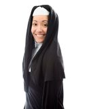 Side profile of a young nun smiling Royalty Free Stock Image