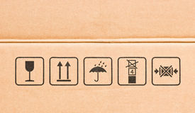 Fragile symbol. Side of real cardboard box with black various fragile symbol stock photos