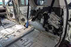 The side rear element of the cab inside the SUV car, dismantled trim, prepared for the replacement and installation of noise royalty free stock photos