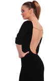 Side rear view of a gorgeous elegant woman Stock Photos