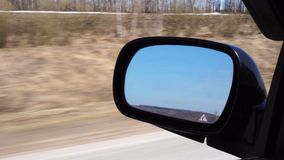 Side rear-view mirror on a car.  stock video footage