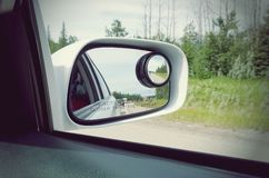 Side rear view mirror on a car Royalty Free Stock Photos