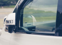 Side rear-view mirror closed for safety Stock Image