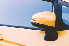 Side rear-view mirror closed for safety Royalty Free Stock Photography