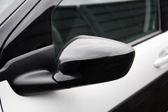 Side rear-view mirror on a modern car Royalty Free Stock Photography