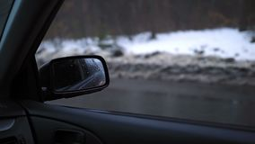 Side rear-view mirror of a modern car stock footage