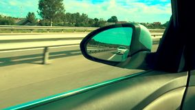 Side mirror of the car. Side rear-view mirror on a modern car, russia, august 2018 stock video footage