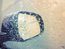 Side rear-view mirror on a old automobile with Raindrops on glass Stock Images