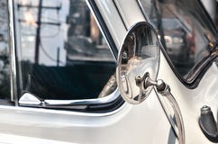 Side rear-view mirror on a old vintage automobile Royalty Free Stock Image