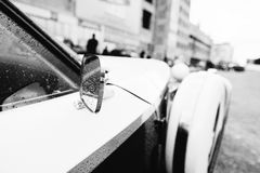 Side rear-view mirror at old vintage retro car. Black and white Royalty Free Stock Image