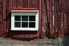Side of red barn with window Stock Images