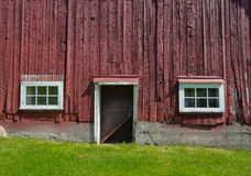 Side of red barn with windows Royalty Free Stock Image