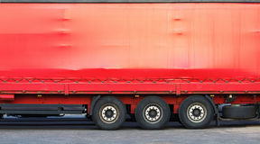 Side of red truck. Close-up of the side of a big red truck. Space for text or image Stock Photos