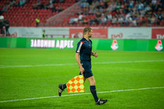 The side referee in action. MOSCOW - MAY 11, 2016: The side referee in action during the soccer game Russian Premier League Lokomotiv (Moscow) vs Kuban ( Royalty Free Stock Photos