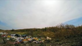 The roadside is littered with rubbish. On the side of the road there are garbage mountains stock video footage