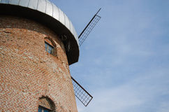 Side of rustic mill with window on sky background Royalty Free Stock Photo