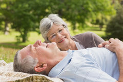 Side of a senior couple lying at park Royalty Free Stock Photo