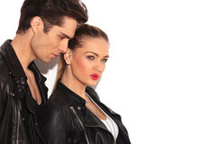Side of young couple in leather jackets looking away royalty free stock images