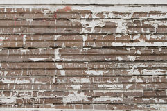 A side of a shingled house. Vintage background from weathered wooden shingle royalty free stock image