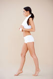 Side shoot of young sporty brunette Royalty Free Stock Photo