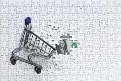 Side Shopping cart full of jigsaw puzzle on money dollar backgro. Und, Business solution concept ,key for success Stock Image