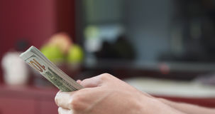 Side shot of man counting three thousand dollars. Wide photo royalty free stock photos