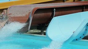 Side shot of waterslide while kids sliding down stock video footage