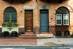 Side by Side. Near symmetry between two front doors, side by side. Philadelphia, PA Stock Photos