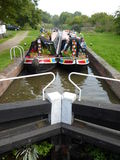 Two narrowboats in canal lock Stock Image