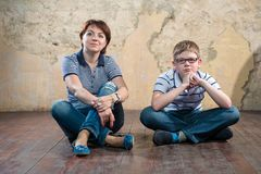 Side by side. Warm regards mom and son Stock Image