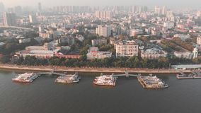 Side span over the boat dock. In the background Guangzhou city, China stock footage