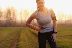 Side stitch - woman runner side cramps. Royalty Free Stock Photography