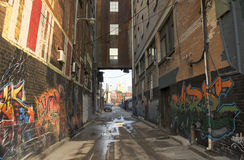Side street. A small side street in Toronto decorated with graffiti Stock Photography