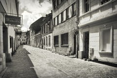 Landmark attraction in Brasov, Romania. Side street in the historic old town Royalty Free Stock Photography