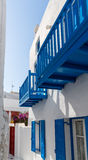 Side street in Mykonos. Blue terrace on a white washed walled house in Mykonos in Greece - traditionally Greek Royalty Free Stock Photos