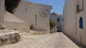 Side street in Sidi Bou Said, Tunisia. Woman going on street in Sidi Bou Said, Tunisia stock video footage