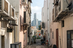 Side street of Tanjong Pagar historic  district in Singapore. Back street of Tanjong Pagar historic  district in Singapore with modern skyscrapers  on the Stock Photography