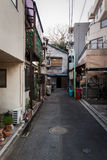 Side street in Tokyo. A typical view down one of the numerous side streets in the old-fashioned Yanaka district of Tokyo Royalty Free Stock Photography