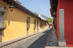 On the side streets in center of Antigua, Guatemala. Colorful old colonial Houses on a sunny afternoon in Antigua, Guatemala. Antigua was declared UNESCO World royalty free stock photos