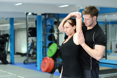 Side stretching in the gym Royalty Free Stock Photos