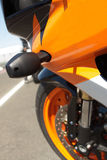 Side of a superbike. Orange superbike next to the racetrack royalty free stock photography