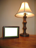 Side table. Lamp and picture frame stock photo