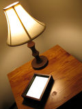 Side table. Lamp and picture frame stock image