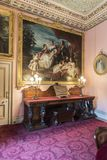 Side table and family portrait Osborne House. Osborne House is a former royal residence in East Cowes, Isle of Wight, United Kingdom. The house was built stock photo