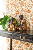 Side table with flowers and interior decoration Royalty Free Stock Photography