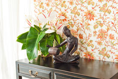 Side table with flowers and interior decoration Stock Photos