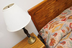 Side table lamp with bed Stock Photo
