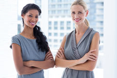 Side to side businesswomen looking at the camera Royalty Free Stock Images