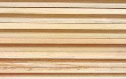 Side of tongue and groove pine boards. Several tongue and groove unfinished pine boards stacked to show the grooves royalty free stock photography