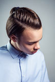 Side top view portrait of young man with top knot hairstyle. Royalty Free Stock Images